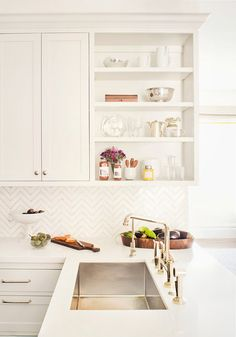 White kitchen and lovely splashback without being too obvious