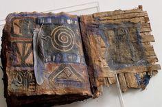Multi-layered books are by artist Inga Hunter
