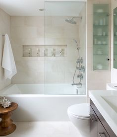 "Contemporary Bathroom by Toronto Interior Design Group | Yanic Simard; Deco Tile in Toronto (decotile.ca) and it's the 12x24"" DaVinci Seris (Type - Bianco Satinato, Colour - White); 60"" tub is Adora Azzura from Mirolin - more info: http://mirolin.com/products/skirted-baths/adora; http://www.houzz.com/photos/673257/Small-Space-Bathroom-contemporary-bathroom-other"