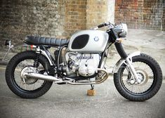 Scrambler UMC-014 BMW 900cc ENGINE: Engine overhauled – new big end shells – new timing chains and tensioners – new piston rings – bores honed – valves checked and ground – stainless pushrod tubes – new clutch friction plates – carbs overhauled and new diaphragms fitted. FRAME: BMW R90/7 Scrambler subframe customised and made into …