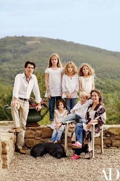 Architect Benedikt Bolza with his wife, Nencia, and their five children at his family's sprawling Umbrian estate, Castello di Reschio, where he rebuilds and manages centuries-old stone houses for clients | archdigest.com