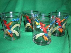 hand painted set of 4 parrots in a palm tree.  hi balls.great set. $12.00, via Etsy.