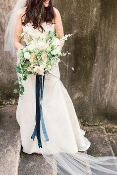 white bouquet with blue velvet ribbon