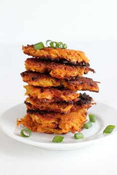 Paleo Sweet Potato Hash Browns: 4 medium sweet potatoes 2 eggs, whisked 1/2 cup almond flour 2 teaspoons sea salt 1/4 cup green onions, chopped (plus some for garnish) 1/4 cup coconut oil
