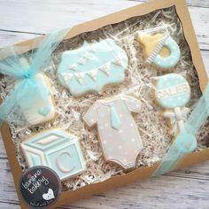 Baby boy cookies  thanks @brpboxshop for great boxes! #baby #babyboy #onesie #pacifier #bottle #block #blue #babygift #sugarcookies #decoratedcookies #customcookies #edibleart #bananabakery