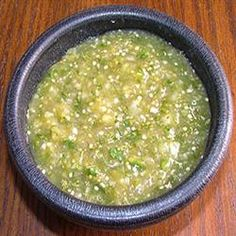 In food processor: fresh tomatillos, green pepper, onion, garlic, jalapenos, cilantro (optional), lime juice, sugar. I've never cooked my tomatillos. So fresh.
