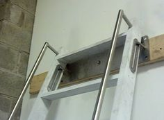 Notice the hardware that allows the ladder to be pushed up and back to the way when not in use. Very cool.