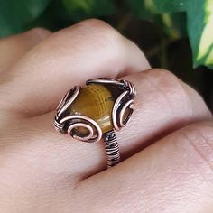 The listing is for one wire tiger eye ring. This gorgeous copper wire ring is entirely handmade, woven by hand, antiqued and treated with wax, hammered for more strength and polished by hand. The central piece is a stunning tiger eye cabochon. Tiger eye is the stone of luck ,