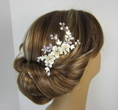 Hey, I found this really awesome Etsy listing at http://www.etsy.com/listing/120743477/flower-hair-comb-bridal-hair-comb