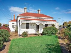 White Victorian house with red roof. 185 Buckley Street, Seddon, Vic 3011