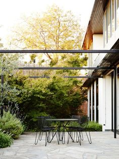 Courtyard - I like how the pergola attaches under the house (which in this case would be under the upper master deck) and its so open it doesn't darken the space, but creates a sense of enclosure . Brian and Trish Perkins — The Design Files