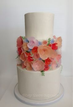 Round Wedding Cakes - Rifle Paper Co. inspired cake. All white fondant with handmade wafer/rice paper flower covered center tier.