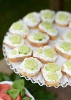 Simple Open-Faced Cucumber Tea Sandwiches Recipe - I used Ritz crackers and cilantro. Pretty good. Very chilling so ideal for summer garden party. I recommend chives. Not convinced you need full amount of herb. Garlic is essential. Don't need much on each cracker. Will make again.
