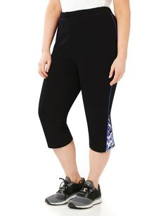 Geo Zip Capri | Catherines  Move in style with our latest capri legging. Contrast piping lines the outer leg and zippers at the hem open to reveal a geo-print inset. Elastic waist. Catherines pants are specifically designed with the plus size woman in mind. #catherinesplus #plussize #plussizefashion #activewear #healthyliving