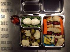 Sausage sliders, boiled eggs, steamed veggies