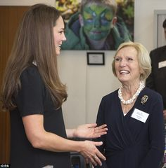 The laughing pair appear to be sharing a joke - perhaps about Prince William's love of Mrs Berry's recipes