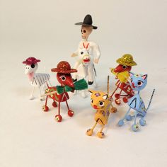 These are small handmade clay dog or cat skeletons. Can't leave out the animals during the most important holiday in Mexico, Day of the Dead! They come in a variety of colors and holding different things in their mouths or wearing hats. Please allow us to choose for you.7 Dogs