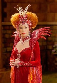 carol burnett in red.....She is so funny. :)  I loved the way she made me laugh in all her skits!