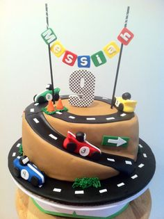 For my little buddy who's turning 9, a Race Car Cake: Red Velvet cake with White Chocolate ganache and White Chocolate fondant. All decor made from fondant and is completely edible.