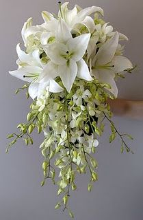 white oriental lilies and white singapore orchids. Would look awesome with a red wedding dress.