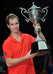 Richard Gasquet holds up Bangkok trophy after defeating Gilles Simon 6-2, 6-1. (ATP)
