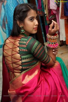 Honey in backless green blouse and red saree