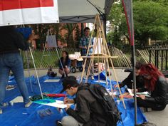 Artists congregate in the park and share their experiences through painting