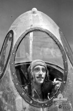Celone, Italy. c. 1944. Informal portrait of 430073 Flying Officer H. Walker of Mitcham, Vic, bombardier, in the nose of his Handley Page Halifax aircraft, before setting out on a supply dropping mission to Yugoslavia.