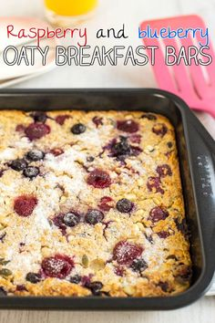 Raspberry and blueberry oaty breakfast bars - an easy make-ahead breakfast to prepare on Sunday night and have ready through the week! Almost 9 grams of protein per bar!