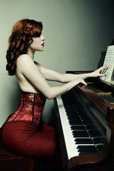 Model, playing the piano.