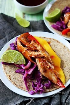 Incredibly flavorful sweet and spicy Thai salmon tacos! A quick and healthy 30 minute dinner that will delight salmon lovers!