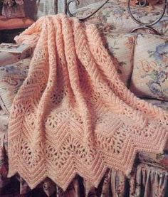 Made with worsted weight yarn for warmth and a size N crochet hook for delicate looseness, this Victorian Lace Afghan is feminine and pretty. Intermediate crochet patterns like this one are elegant and popular in just about any home.