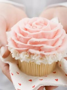 Photographic Print: Hands Holding Cupcake with Marzipan Rose Poster : 24x18in