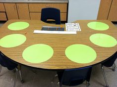 Vinyl circle cut-outs used as dry erase boards at small group table.  Time saving and brilliant!