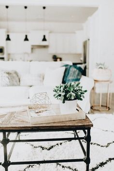 gorgeous white living room | moroccan print rug, couch, open floor plan, white cabinets, home inspiration, house, living space, room, scandinavian, nordic, inviting, style, comfy, minimalist, minimalism, minimal, simplistic, simple, modern, contemporary, classic, classy, chic, girly, fun, clean aesthetic, bright, white, pursue pretty, style, neutral color palette, inspiration, inspirational, diy ideas, fresh, stylish, 2018, sophisticated