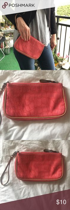 "Ann Taylor LOFT Clutch Measures approx. 9.5"" x 6"". Coral pink clutch from Ann Taylor LOFT. Faux leather with ""scaly"" texture. Has a strap on the outside that you can put around your wrist. Zipper closure. Inside has slots for cards and a zipper pouch for small items. Minimal signs of wear on the outside. Inside shows no signs of wear. Please let me know if you have any questions! LOFT Bags Clutches & Wristlets"