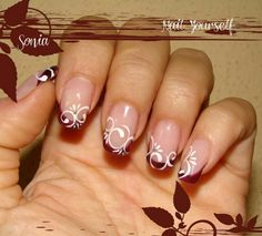 Red French-Tip Nails with White Flower Swirl Design id do different colors..