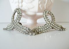 Vintage Rhinestone Shoe Clips Large Clear Rhinestones Ribbon Loop Dangle Silver Shoe Clips $47 aud -  Vintage item from the 1950s. Materials: rhinestone, silver tone, clear rhinestone.