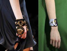 bold cuff bracelet with dangling medallion bracelets