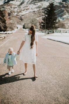The perfect spring time outfits for dressing up on mama and her toddler. I love her lace dress and I can't get over his little seersucker blazer!