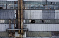 Wall of a run down factory warehouse near the South Boston dry dock.
