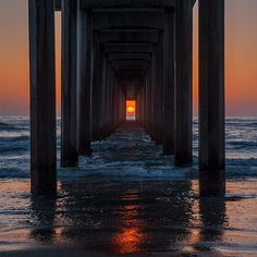 Twice a year, the setting sun lines up with Scripps Pier. May 2, 2013 was such a night. Photo: John H. Moore