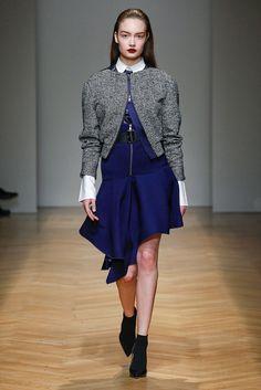 Asymmetrical wool skirt and herringbone bomber on white shirt at AquilanoRimondi FW2017-18 fashion show.