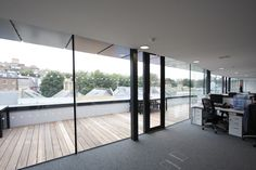 an aluminium casement door is used as access in the wall of structural glass to the roof terrace  www.iqglassuk.com