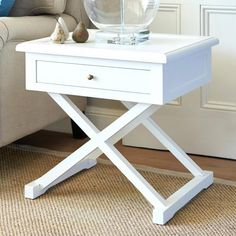Our Hamptons style white side table features cross legs and a small drawer for handy storage. Perfect as a side table to a sofa or as a bedside table. It is also available in oak and black. Availability: In stock White Round Side Table, Timber Beds, White Console Table, Small Drawers, White Crosses, Bedroom Accessories, The Hamptons, Bedroom Decor, Furniture