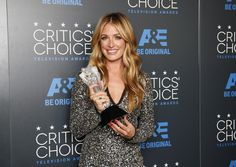 "TV personality Cat Deeley poses backstage with her award for Best Reality Series Host for the FOX show ""So You Can Think You Can Dance"" during the 5th Annual Critics' Choice Television Awards. REUTERS/Danny Moloshok"