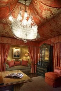 Love the pirate ship chandelier, but I also like the fabric used on the ceiling.  This could be so easy to do even in an apt. with the right colors and patterns.