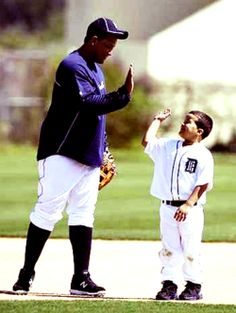 Miguel Cabrera with Prince Fielder's son. My heart is now warm