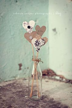 Paper heart on a stick with a flower or 2 in a small vase.  10 Simple Valentine Decorations - HoneyBear Lane