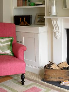 Victorian fireplace and pink upholstered chair. I like the shelving on the side of the chimney